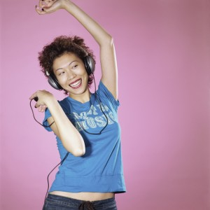 Woman with Headphones Dancing --- Image by © Royalty-Free/Corbis